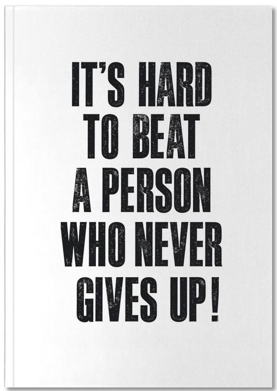 It's Hard to Beat a Person Who Never Gives Up Notebook