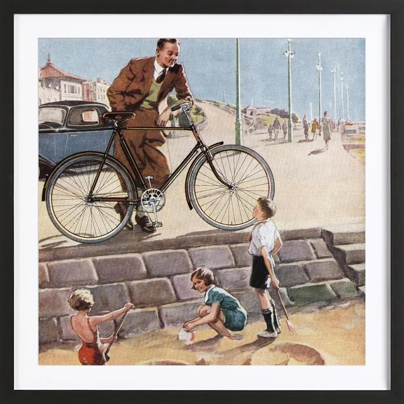 Cycling in The Sand Framed Print