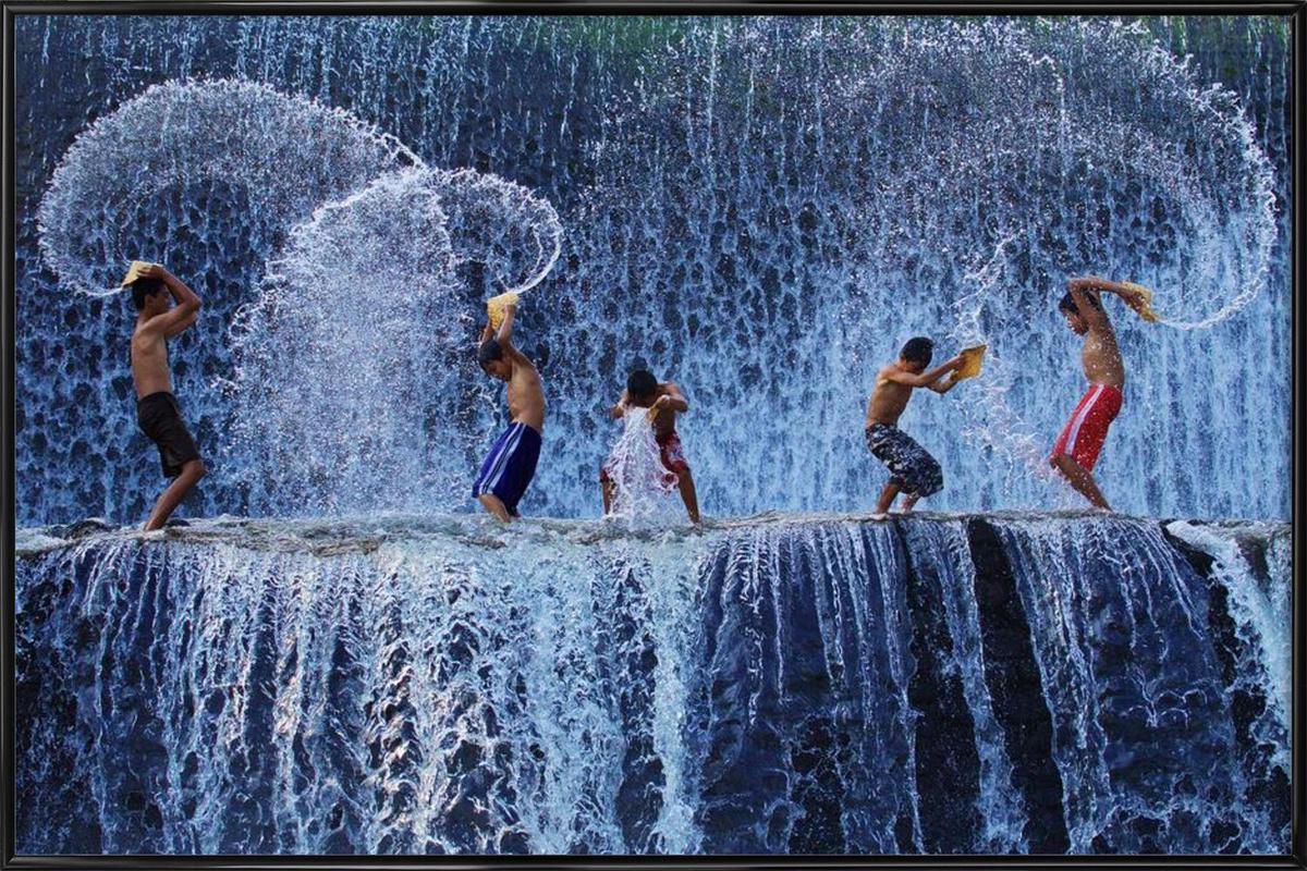Playing with splash - Angela Muliani Hartojo Framed Poster