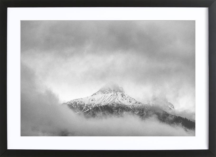 Peak in the Clouds Framed Print